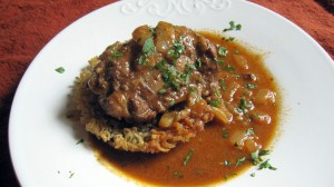 Chicken thigh on tahdig with butter sauce